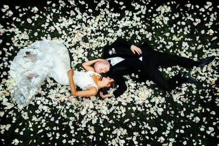 Surround yourself with rose petals for a romantic, unforgettable wedding photo |...