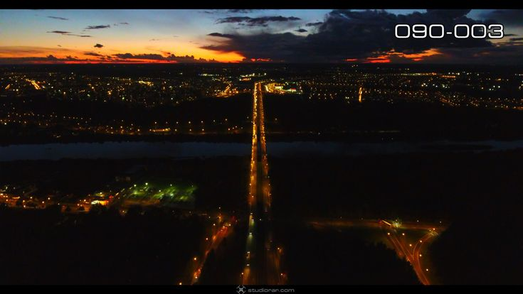 Night illuminated highway of rolling city streets and districts – Drone Aerial...