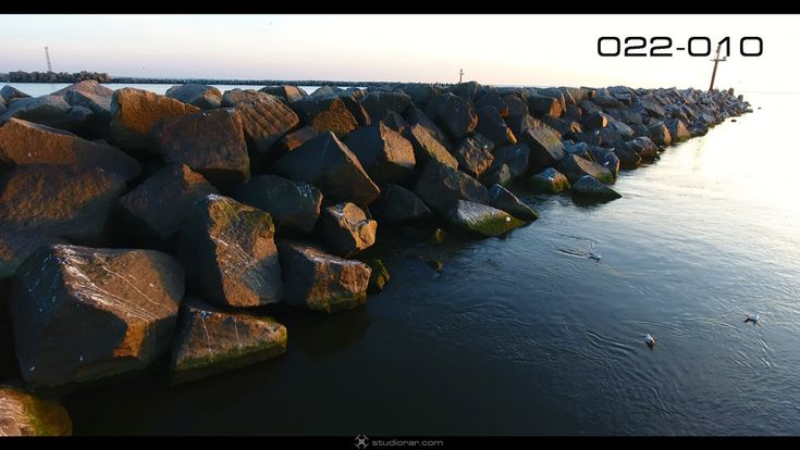 Sea breakwater from above – Drone Aerial Photography, Videography Services & V...