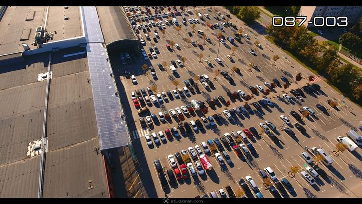 Vertical view of cars at shopping center parking lot – Drone Aerial Photograph...
