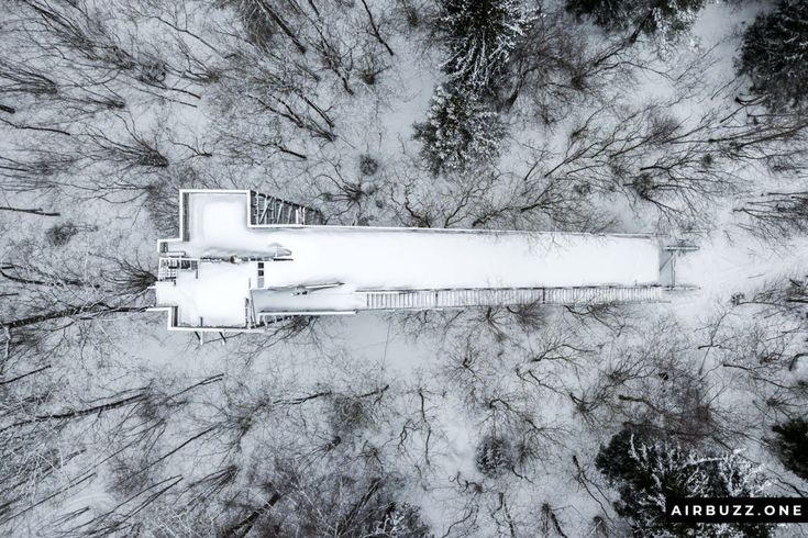 Straight above bird's eye view of the abandoned ski jump.  Flying over a derelic...