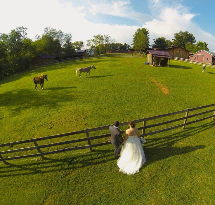 This couple had a drone take wedding photos from above to capture their whole rustic landscape! So unique! #dronephotographyideas
