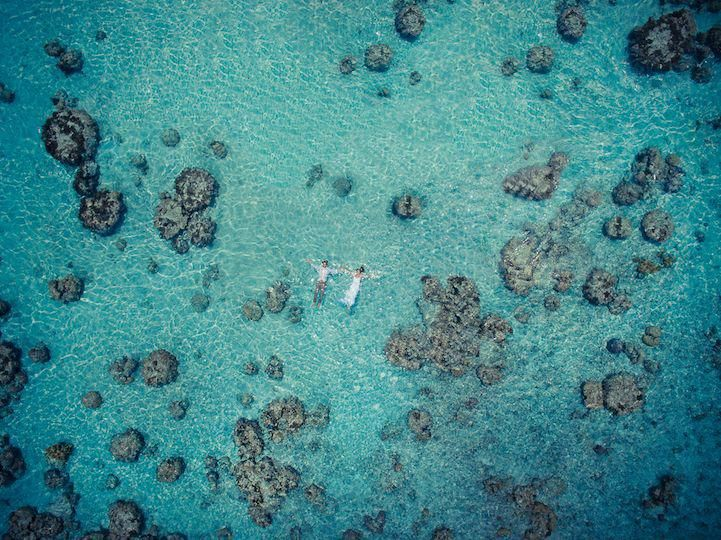 Photographer captures amazing wedding photos using drones making the couple seem like they are the only two people in the world. #PicturePerfectDronesphotography