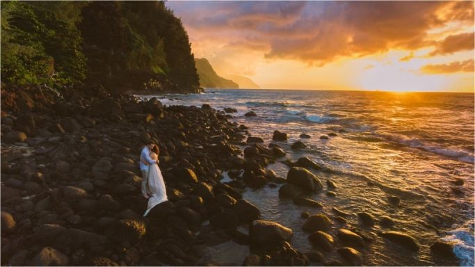 Adventure Elopement Drone Photography on Kauai Hanakapiai Na Pali Coast Wedding. Ke'e Beach North Shore drone photography by Bradyhouse Media and Meg Courtney