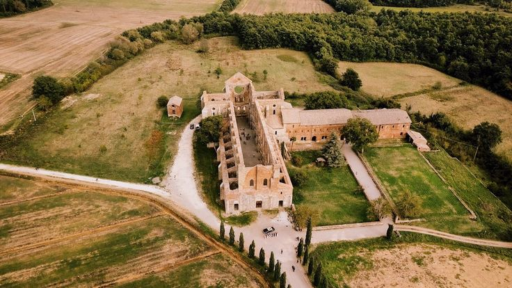 Drone screenshot of San Galgano Abbey, Tuscany Wedding video by Gattotigre - wedding videographer in Italy