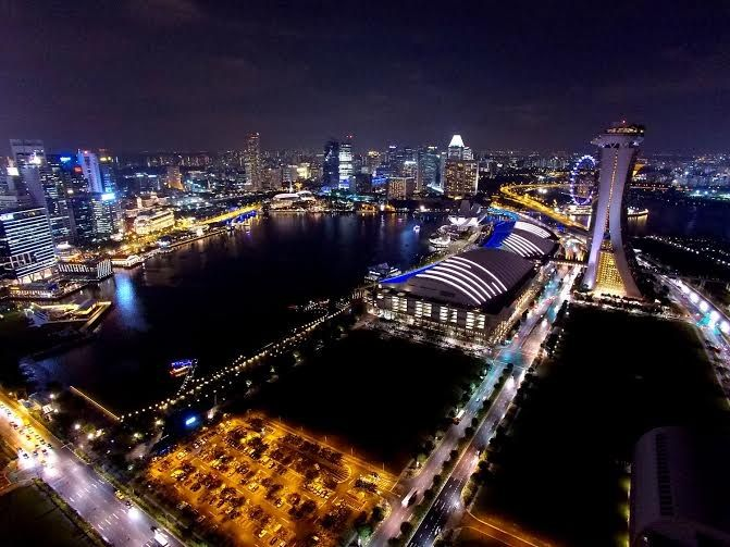 Sparkling Singapore flyer and lighted skyscrapers no words can describe the beauty of Singapore in night. It just shines like a twinkling star everywhere. #singapore #aerialphotography #aerialvideo