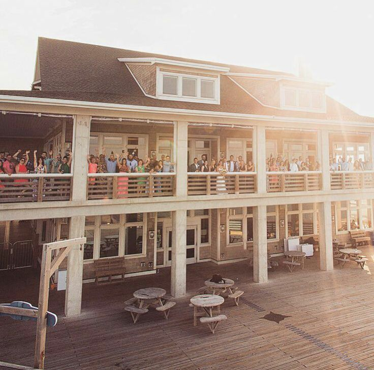 Wedding guests enjoying the wraparound porch at Jennette's Pier.  Jennette's Pie...