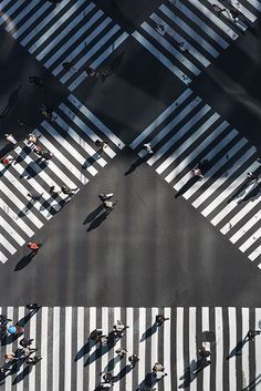 An overhead shot at people walking at a pedestrian crossing - candid photography...