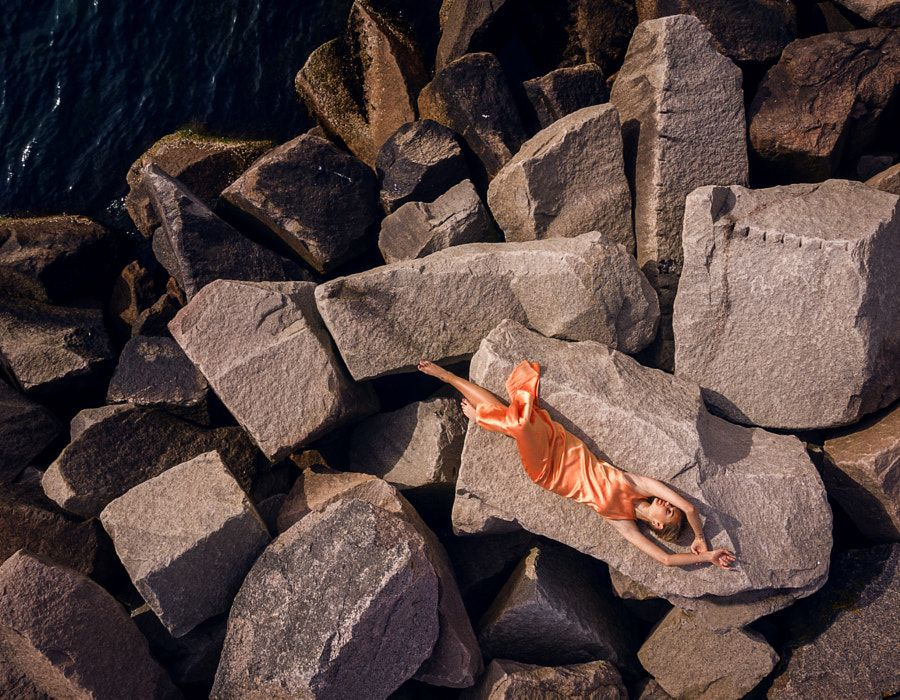 Girl on the rocks - Drone Shot
