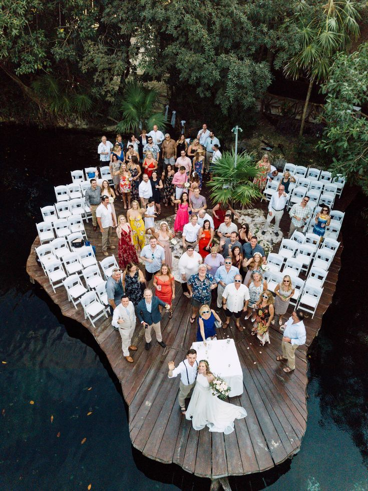 A destination wedding at Cancun Mexico with a drone capturing the guest at the wedding ceremony
